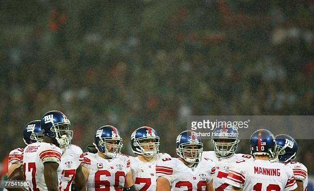 The Giants offence listens to their quarterback Eli Manning during the NFL Bridgestone International Series match between New York Giants and Miami...
