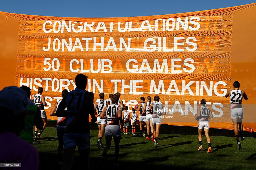 The Giants run out onto the field during the round eight AFL match between the West Coast Eagles and the Greater Western Sydney Giants at Patersons Stadium on May 11, 2014 in Perth, Australia.