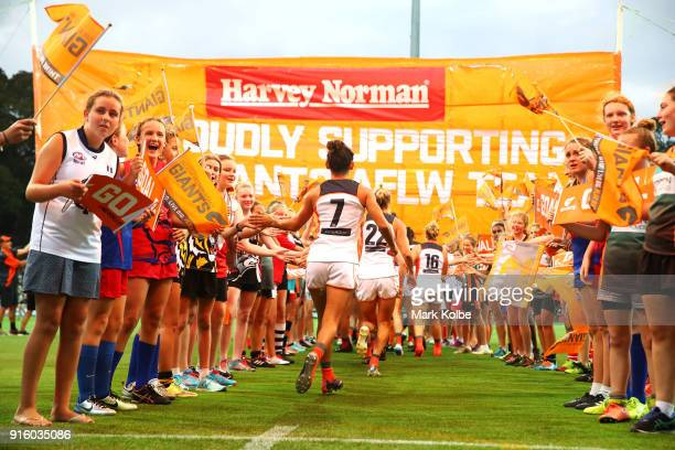The Giants runs out during the round 20 AFLW match between the Greater Western Sydney Giants and the Carlton Blues at Drummoyne Oval on February 9...