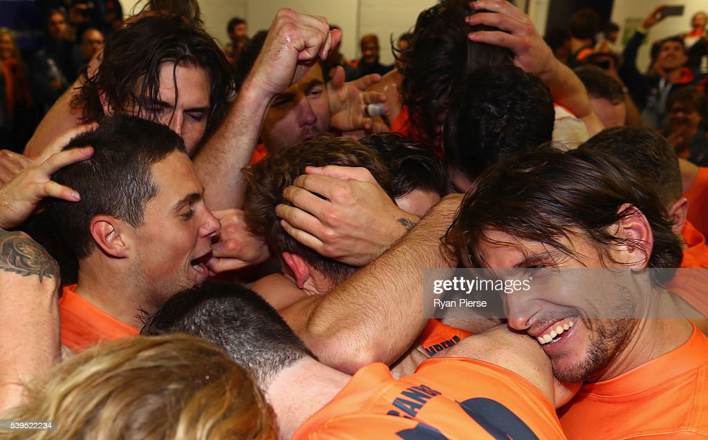 The Giants sing the club song after the round 12 AFL match between the Greater Western Sydney Giants and the Sydney Swans at Spotless Stadium on June 12, 2016 in Sydney, Australia.