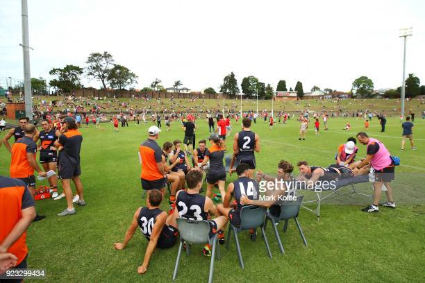 The Giants sit on the field during the halftime break of the AFL Inter Club match between the Sydney Swans and the Greater Western Sydney Giants at...