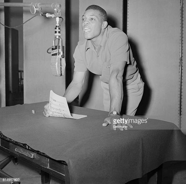 The Giant's Willie Mays, who has been making himself heard around the National League with his big bat, tries his hand, , in the musical...