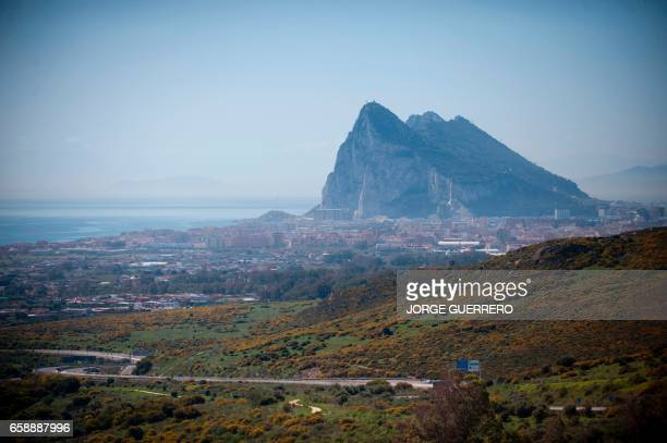 The Gibraltar Rock is pictured from La Linea de la Concepcion near ther southern Spanish city of Cadiz on March 28 2017 Gibraltar the British...