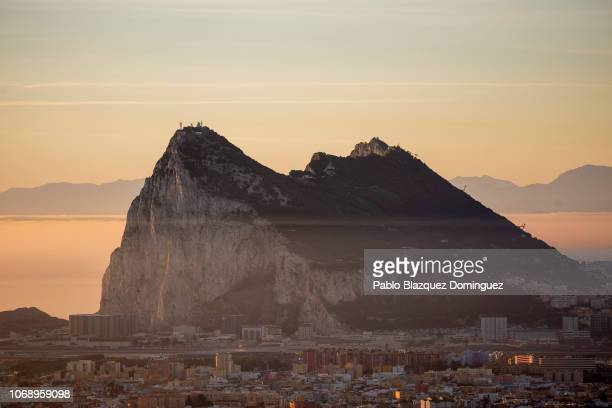 The Gibraltar Rock is seen at sunrise from the Spanish side on December 6 2018 in La Linea de la Concepcion Spain More than 10000 workers cross the...