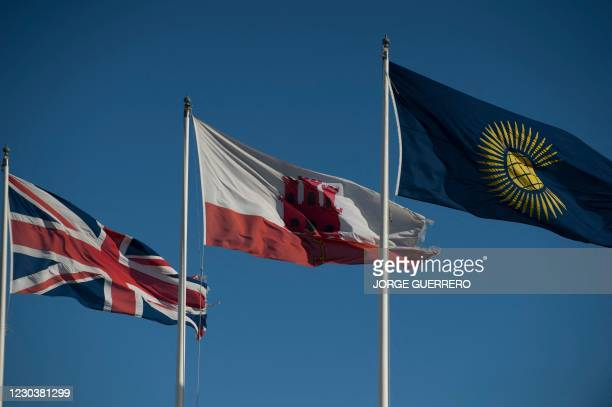 The Gibraltar's flag and the Union Jack flies in Gibraltar on January 1, 2021. - Gibraltar will become part of Europe's passport-free zone to keep...