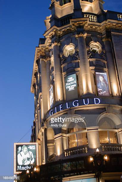 The Gielgud Theatre on Shaftsbury Street in London, England illuminated at sunset. The posters for Patrick Stewart's Macbeth are on the building.