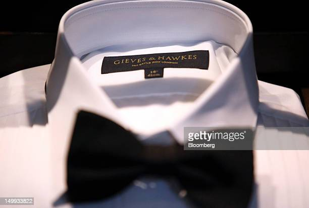 The Gieves Hawkes company logo is seen inside a dress shirt at the company's store on Saville Row in London UK on Tuesday Aug 7 2012 UK retail sales...