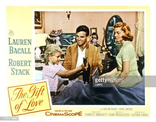 The Gift Of Love, lobbycard, from left, Evelyn Rudie, Robert Stack, Lauren Bacall, 1958.