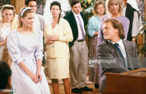 CHEERS The Gift of Woodi Episode 19 Airdate 4/6/89 Pictured Jackie Swanson as Kelly Gaines Woody Harrelson as Woody Boyd