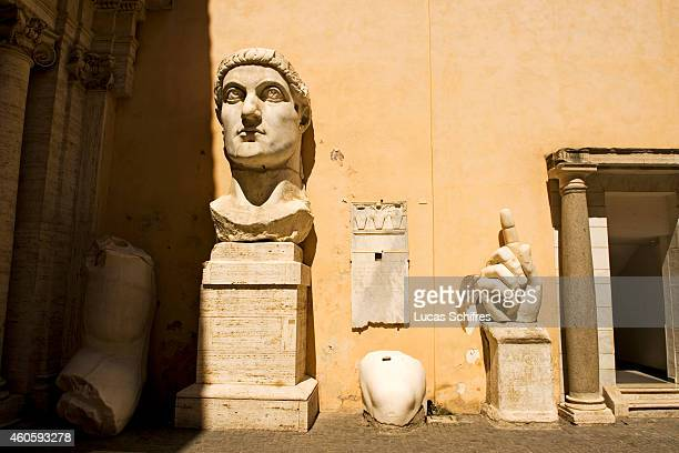The gigantic hand and head of the Colossus of Constantine stand on display in the courtyard of the Capitoline Museums on August 19 in Rome, Italy....