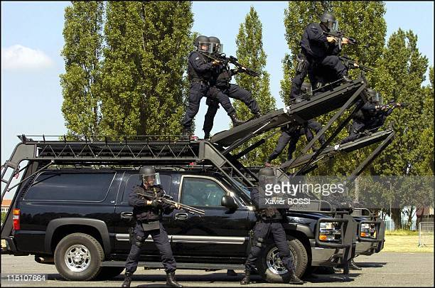 The GIGN celebrates its 30 years in Satory France on June 15 2004 The GIGN and HARAS of the American SWATEC a intervention vehicle with a sliding...