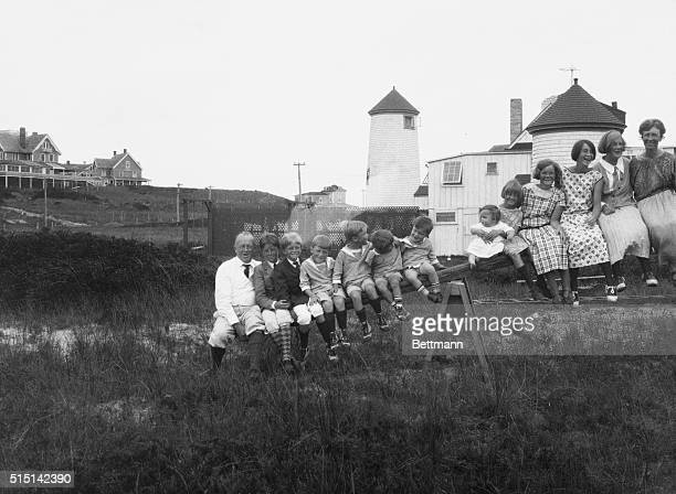 The Gilbreth family sits atop a seesaw while they spend their 1923 summer in an old lighthouse on Nantucket Island From left to right are Major Frank...