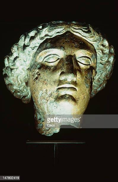 The gilt bronze head of the goddess Sulis Minerva found in the Roman Baths at Bath UK circa 1990 She is a composite of the Roman goddess of wisdom...