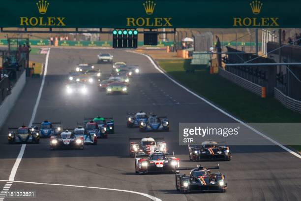 The Ginetta driven by Charles Robertson of Britain leads ahead of the Toyota driven by Kamui Kobayashi of Japan at the start of the FIA World...