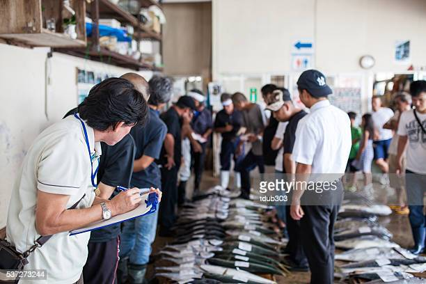 The Ginowan fish market prepares to auction off daily catch