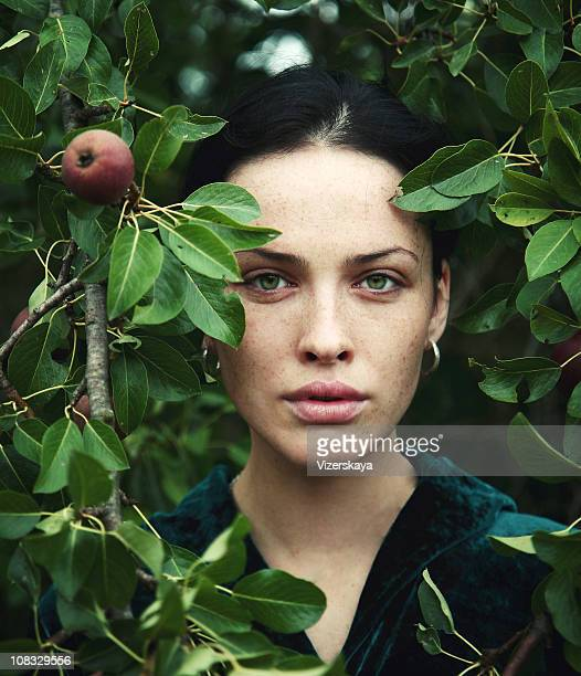 the girl and an apple-tree - green eyes stock pictures, royalty-free photos & images