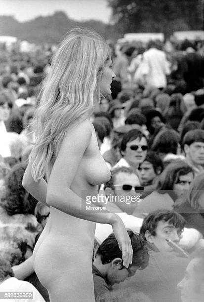 The girl and her boyfriend who stripped naked and then made love in public during the concert July 1970 706856003