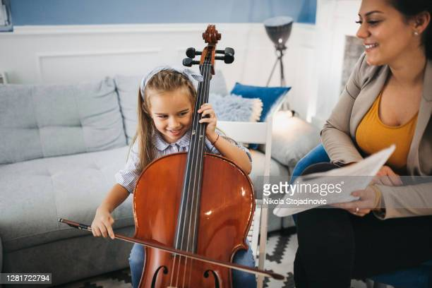 the girl and her cello - performing arts event stock pictures, royalty-free photos & images