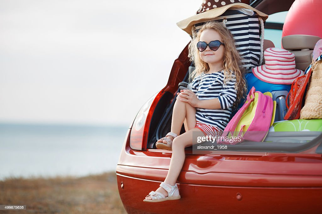 The girl and stuff in the open trunk