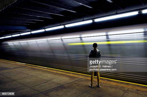 the girl and the night train - subway platform stock pictures, royalty-free photos & images