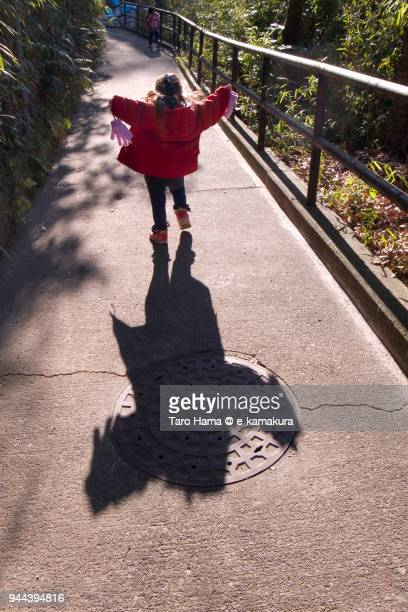The girl climbing the slope of the street in Japan