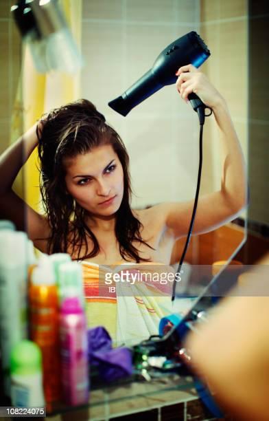 The girl dries hair