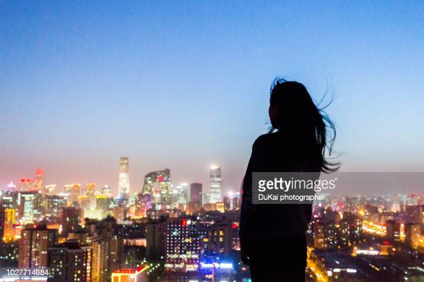 the girl is in beijing cbd - beijing province stock photos and pictures