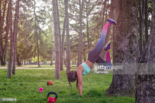 the girl is stretching on a tree - little girls bare bum stock pictures, royalty-free photos & images