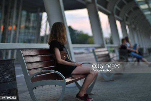 The girl is waiting for a bus
