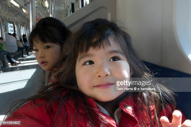 The girl laughing in the train in Japan