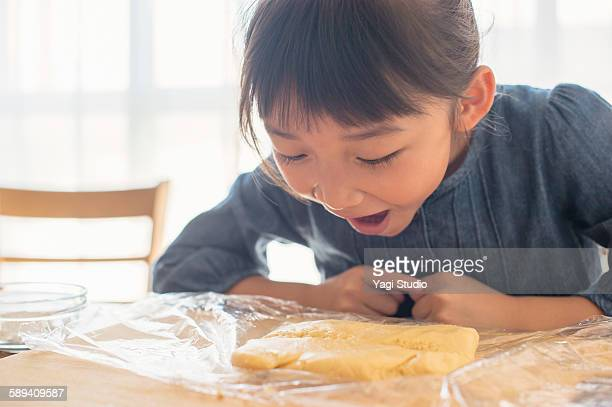 The girl laughing to see the cookie dough