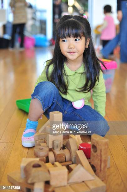 The girl playing in the kindergarten in Japan