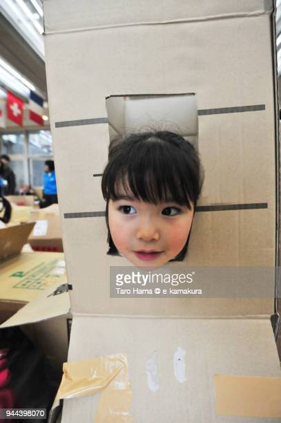 The girl playing in the maze made by cardboards in Japan