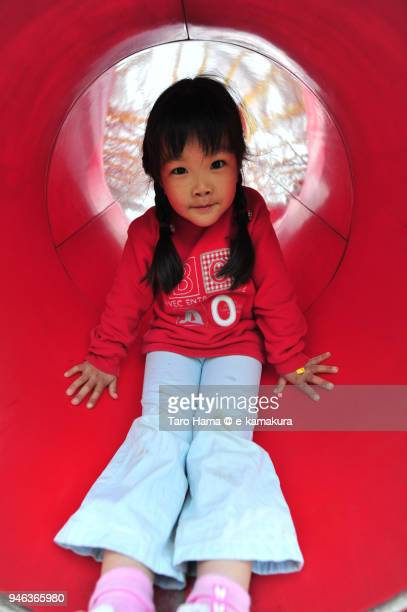 The girl playing in the slide in Japan