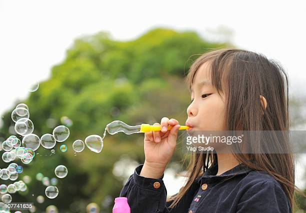 The girl playing with the soap bubble