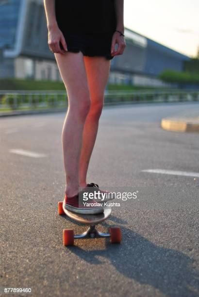 The girl ride on a longboard