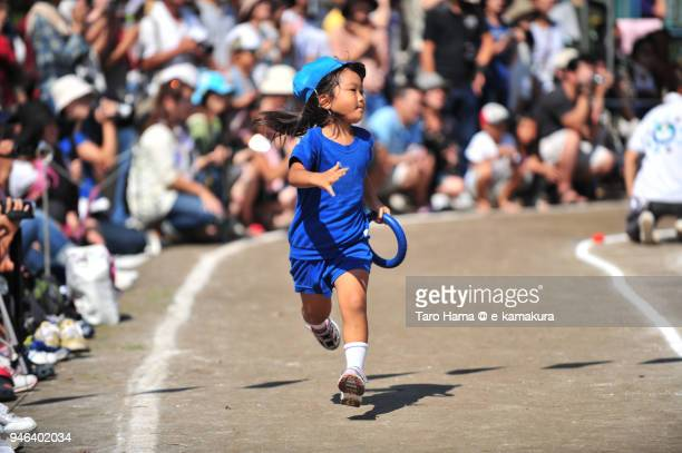 The girl running in the athletic meet in Japan