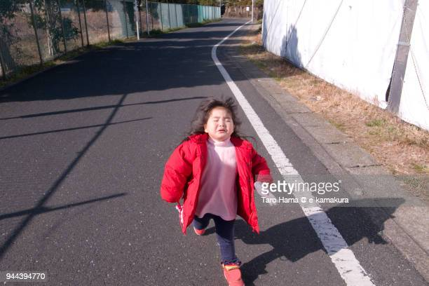 The girl running on the road in Japan