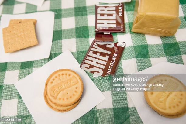 The Girl Scout version of s'mores includes their cookies Traditional ThanksALot or Lemonades with melted marshmallows and chocolate inbetween...