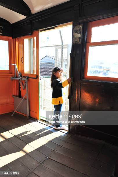 The girl standing at the entrance of the train in Japan