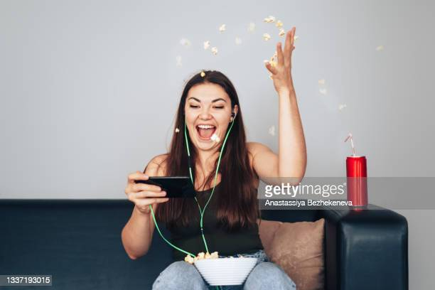the girl watches the e-sports stream and rejoices in the victory - international match stock pictures, royalty-free photos & images