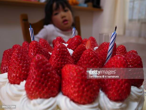 The girl watching a birthday cake at home in Japan