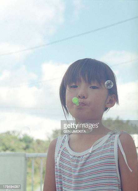 The girl who plays a bubble