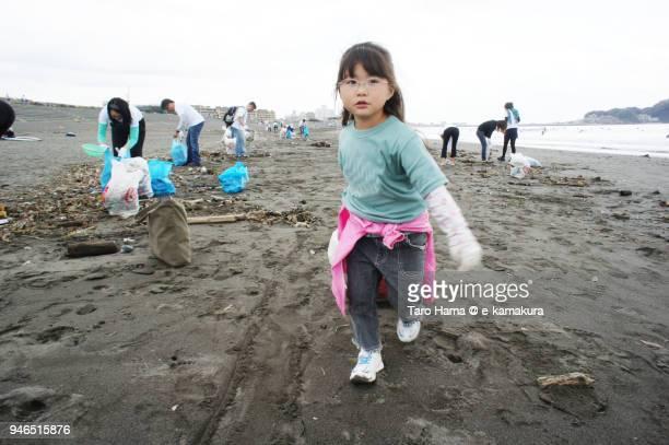 The girl working as a volunteer in Fujisawa in Japan