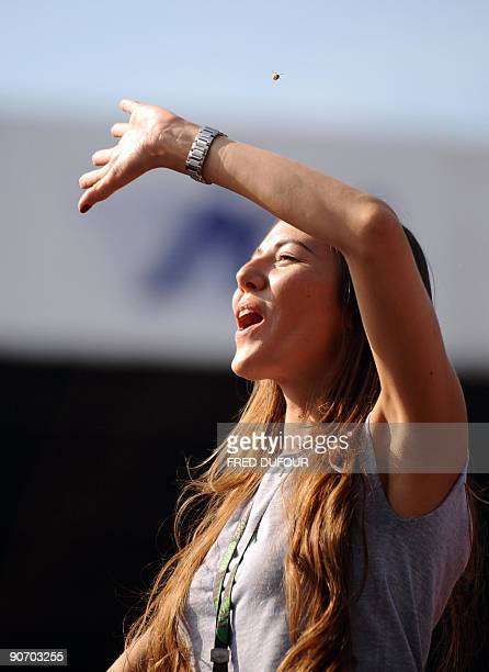 The girlfriend of Brawn GP's British driver Jenson Button Japanese model Jessica Michibata cheers in front of the podium of the Autodromo Nazionale...
