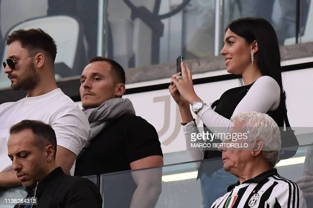 The girlfriend of Juventus' Portuguese forward Cristiano Ronaldo Georgina Rodriguez takes photos after Juventus secured its 8th consecutive Italian...