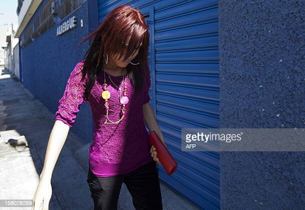 The girlfriend of US internet security pioneer John McAfee Belize's Samantha Vanegas walks outside the detention center of the immigration...