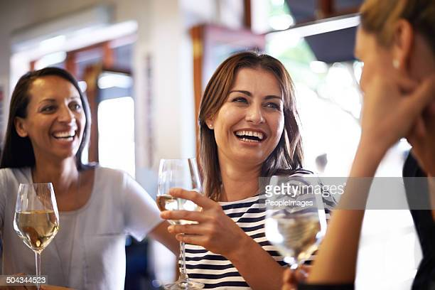 the girls celebrating with a glass of wine - mid adult women stock pictures, royalty-free photos & images