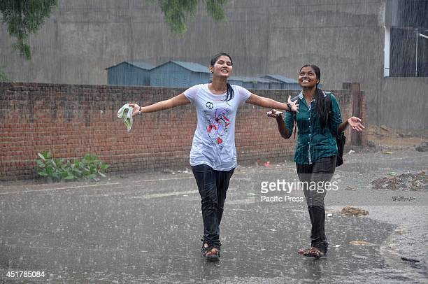 The girls enjoy the rain in Allahabad It is expected that the monsoon rain will hit the region starting in July and lasting till September yearly