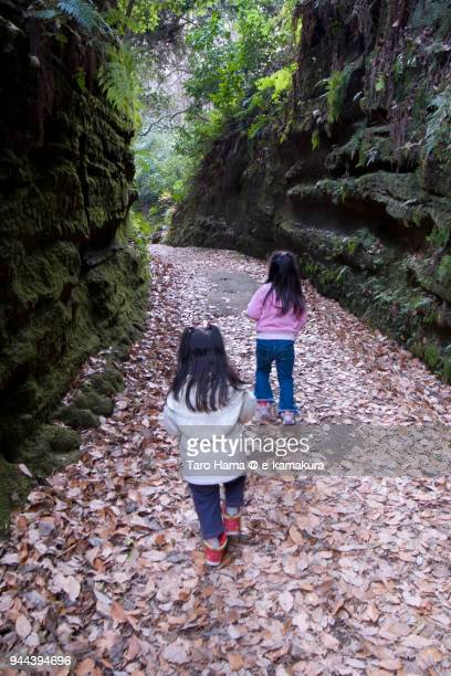 The girls hiking on the ancient road in Kamakura and Yokohama in Japan